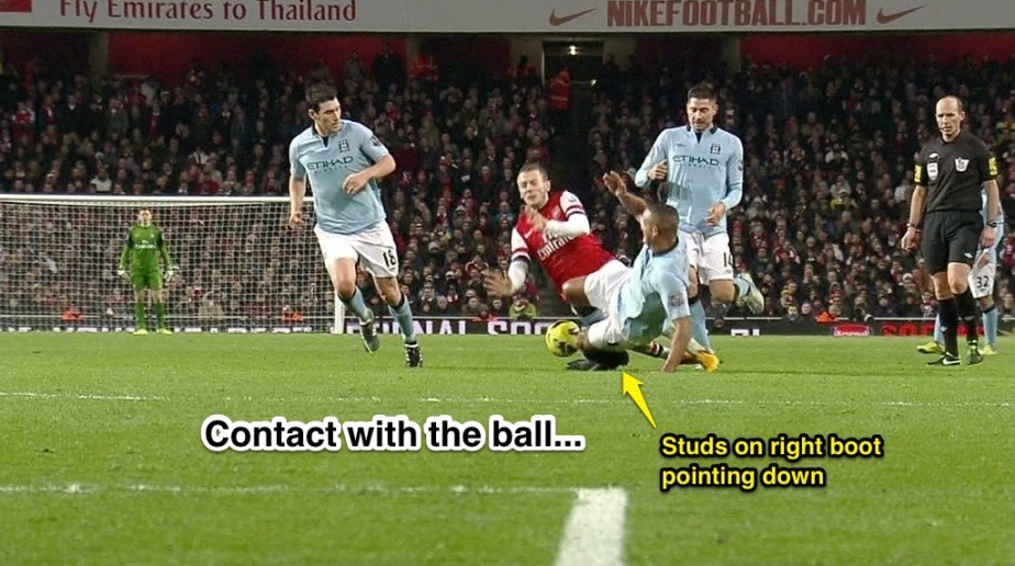 kompany-tackle-on-wilshere-12